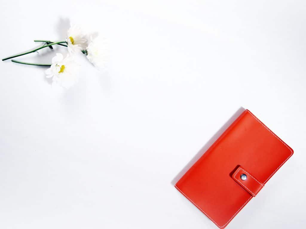 desktop with wallet and flowers