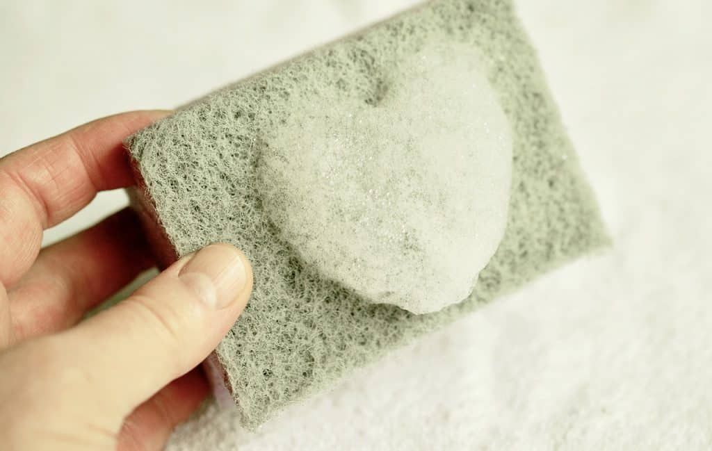 green sponge used for natural cleaning products