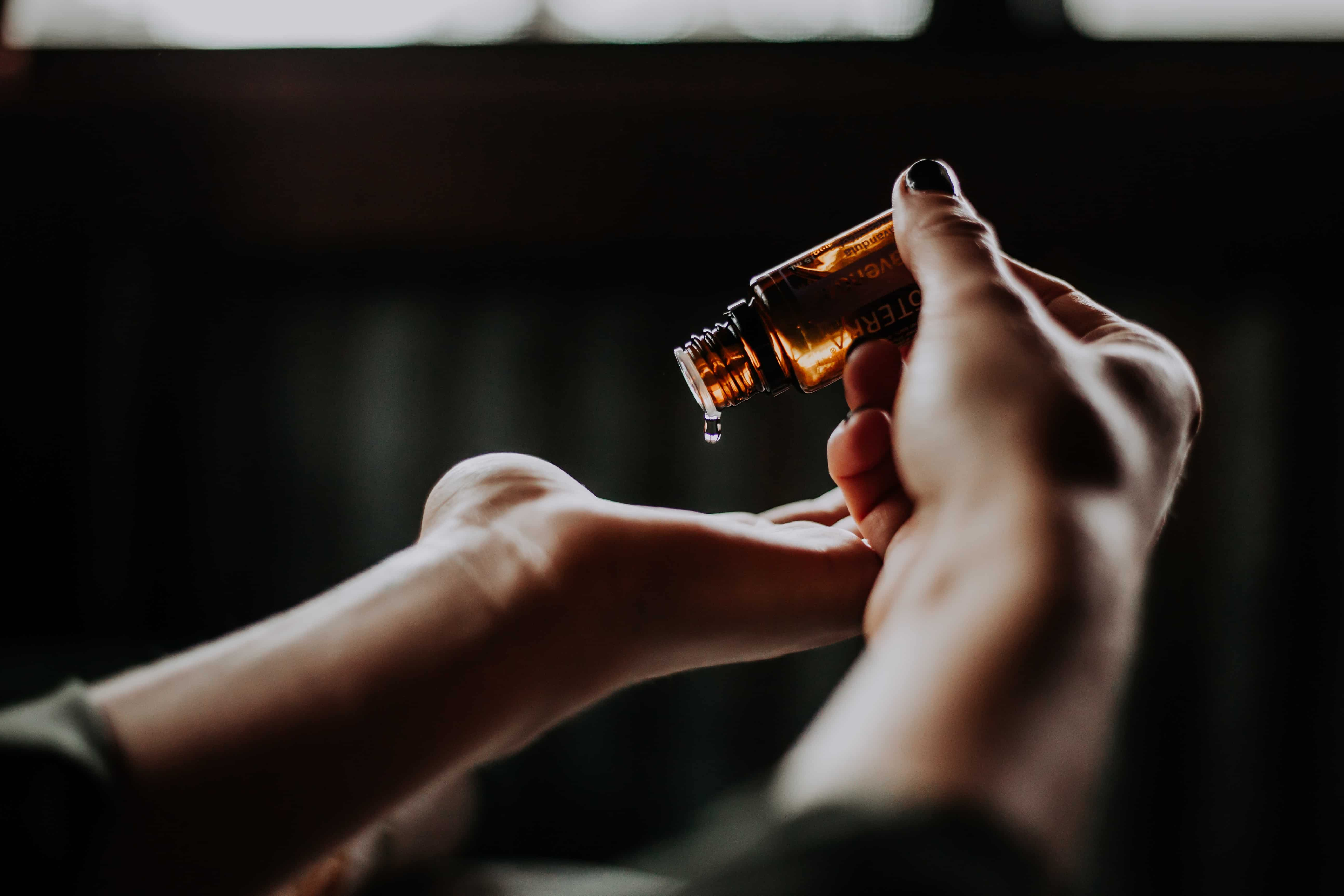 woman applying non-toxic essential oil