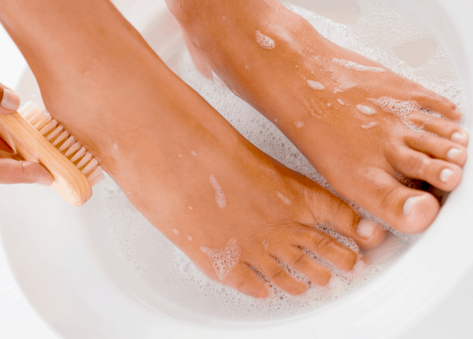 woman cleaning her feet after using detox pads